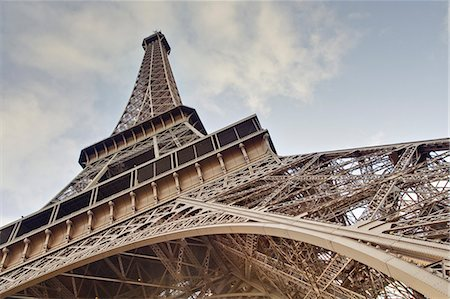 The Eiffel Tower towers overhead, Paris, France, Europe Stock Photo - Rights-Managed, Code: 841-07541160