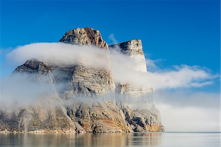 Fog lifting on the steep cliffs of Icy Arm, Baffin Island, Nunavut, Canada, North America Stock Photo - Rights-Managed, Code: 841-07589821