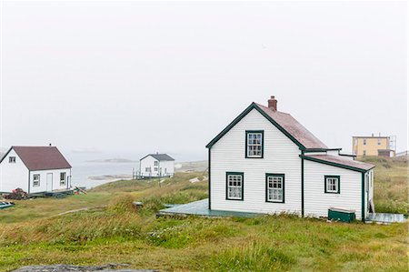 Fog rolls in over the small preserved fishing village of Battle Harbour, Labrador, Canada, North America Stock Photo - Rights-Managed, Code: 841-07589831