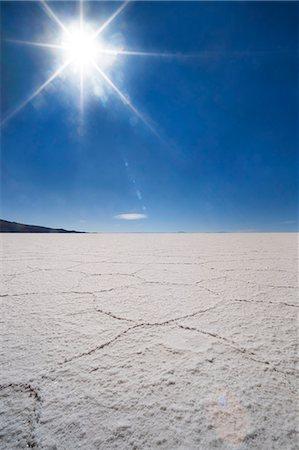 salt - Backlit with sun star shot of hexagonal shaped salt flats, Salar de Uyuni, Bolivia, South America Stock Photo - Rights-Managed, Code: 841-07590514