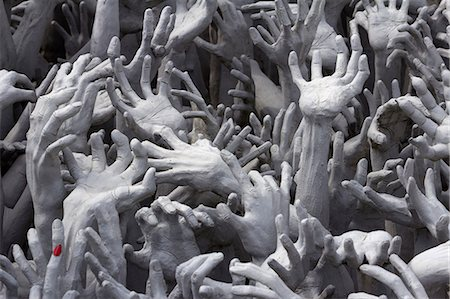 Detail of hands, Wat Rong Khun (White Temple), Chiang Rai, Northern Thailand, Thailand, Southeast Asia, Asia Stock Photo - Rights-Managed, Code: 841-07590533