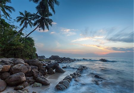 dreamy - Sunrise at a secluded lagoon with rocks and palm trees framing the view, Tangalle, Sri Lanka, Indian Ocean, Asia Stock Photo - Rights-Managed, Code: 841-07600057