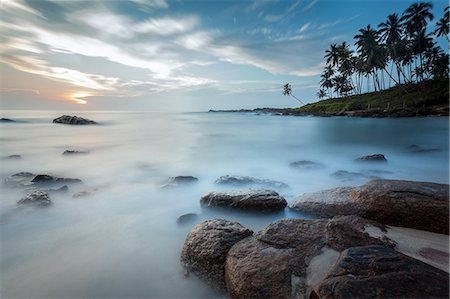 dreamy - Sunrise at a secluded lagoon with rocks and palm trees framing the view, Tangalle, Sri Lanka, Indian Ocean, Asia Stock Photo - Rights-Managed, Code: 841-07600059