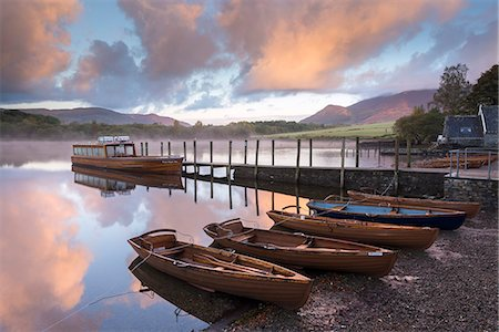 Boats moored on Derwent Water at dawn in autumn, Keswick, Lake District, Cumbria, England, United Kingdom, Europe Stock Photo - Rights-Managed, Code: 841-07673419