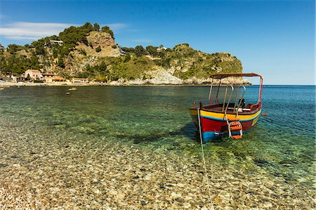Excursion boat moored on pretty Isola Bella Bay in this popular northeast tourist town, Taormina, Catania Province, Sicily, Italy, Mediterranean, Europe Stock Photo - Rights-Managed, Code: 841-07673478