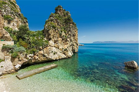 rock - Lovely limestone cove at the Tonnara di Scopello, an old tuna fishery and now a popular beauty spot, Scopello, Trapani, Sicily, Mediterranean, Europe Stock Photo - Rights-Managed, Code: 841-07673484