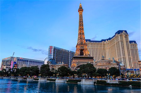 Paris, Ballys and Flamingo Hotels and High Roller Observation Wheel at dusk, viewed across Bellagio Lake, Las Vegas, Nevada, United States of America, North America Stock Photo - Rights-Managed, Code: 841-07782004