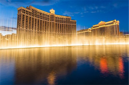Bellagio and Caesars Palace reflections at dusk with fountains, The Strip, Las Vegas, Nevada, United States of America, North America Stock Photo - Rights-Managed, Code: 841-07782006