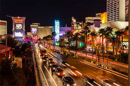 Neon lights, Las Vegas Strip at night with cars leaving light streaks in front of Caesars, Mirage and Flamingo, Las Vegas, Nevada, United States of America, North America Stock Photo - Rights-Managed, Code: 841-07782010