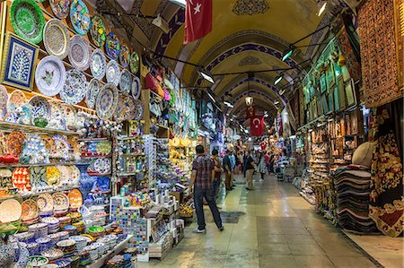 Shops and sellers (vendors) selling Turkish pottery, carpets, kilims, Grand Bazaar, Istanbul, Turkey, Europe Stock Photo - Rights-Managed, Code: 841-07801559