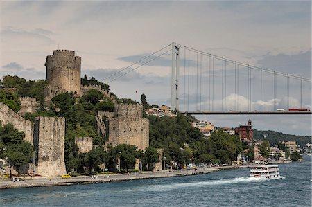 Rumeli Hisari (Fortress of Europe) and Fatih Sultan Mehmet Suspension Bridge, Hisarustu, Bosphorus Strait, Istanbul, Turkey, Europe Stock Photo - Rights-Managed, Code: 841-07913752