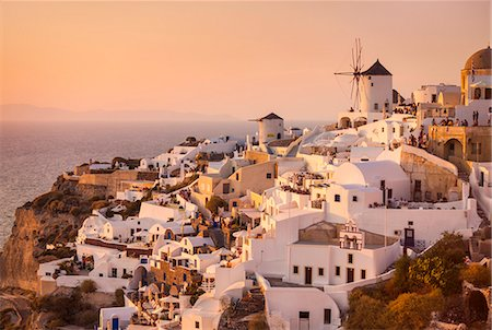 Windmill and traditional houses at sunset, Oia, Santorini (Thira), Cyclades Islands, Greek Islands, Greece, Europe Stock Photo - Rights-Managed, Code: 841-07913783