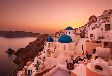 Greek church with three blue domes at sunset, Oia, Santorini (Thira), Cyclades Islands, Greek Islands, Greece, Europe Stock Photo - Rights-Managed, Code: 841-07913790