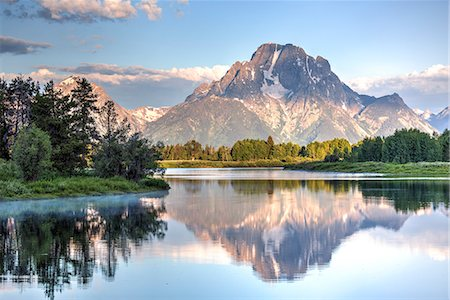 snow capped - Water reflection of Mount Moran, taken from Oxbow Bend Turnout, Grand Teton National Park, Wyoming, United States of America, North America Stock Photo - Rights-Managed, Code: 841-07913905