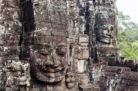 Buddha face carved in stone at the Bayon Temple, Angkor Thom, Angkor, UNESCO World Heritage Site, Cambodia, Indochina, Southeast Asia, Asia Stock Photo - Rights-Managed, Code: 841-08059480