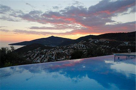 Infinity pool at sunset, Mediteran Hotel, Kalkan, Lycia, Antalya Province, Mediterranean Coast, Southwest Turkey, Turkey, Asia Minor, Eurasia Stock Photo - Rights-Managed, Code: 841-08059639
