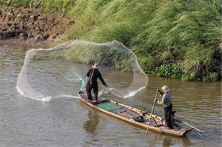 southeast asian ethnicity - Man casting net on the Tonle Sap River near Phnom Penh, Cambodia, Indochina, Southeast Asia, Asia Stock Photo - Rights-Managed, Code: 841-08101649