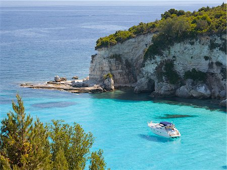 View from hillside over secluded Voutoumi Bay, solitary boat at anchor, Antipaxos, Paxi, Corfu, Ionian Islands, Greek Islands, Greece, Europe Stock Photo - Rights-Managed, Code: 841-08101784