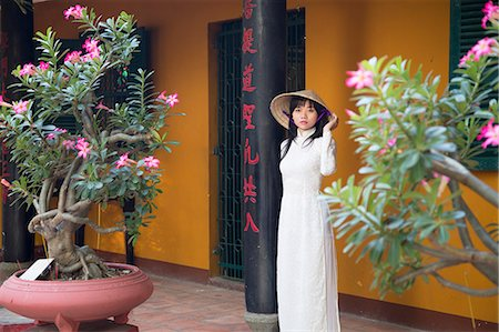 Woman wearing ao dai dress at Giac Lam Pagoda, Ho Chi Minh City, Vietnam, Indochina, Southeast Asia, Asia Stock Photo - Rights-Managed, Code: 841-08102071