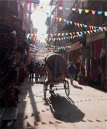 A rickshaw driving through the streets of Kathmandu, Nepal, Asia Stock Photo - Rights-Managed, Code: 841-08102112