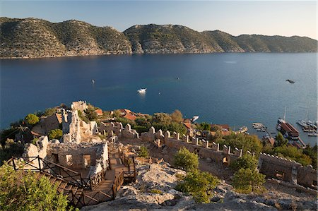 View over castle and Kekova, Simena (Kalekoy), near Kas, Lycia, Antalya, Mediterranean Coast, Southwest Turkey, Anatolia, Turkey, Asia Minor, Eurasia Stock Photo - Rights-Managed, Code: 841-08102226