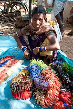 Young woman with ropes of coloured bangles for sale in Mali weekly tribal market, Guneipada, Koraput district, Orissa (Odisha), India, Asia Stock Photo - Rights-Managed, Code: 841-08149675