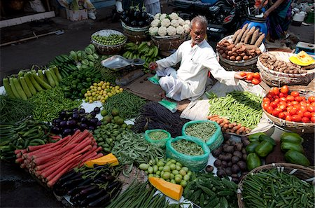 food stalls - Subji wallah (vegetable seller) sitting at his beautifully laid out vegetable stall in the market, Ahmedabad, Gujarat, India, Asia Stock Photo - Rights-Managed, Code: 841-08149672