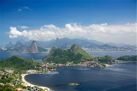 View of Rio, the Serra da Carioca mountains and Sugar Loaf with Charitas and Sao Francisco beaches in Niteroi in the foreground, Rio de Janeiro, Brazil, South America Stock Photo - Rights-Managed, Code: 841-08211509