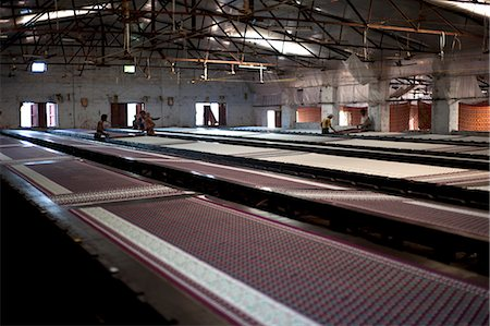 Screenprinting factory, men printing sari lengths of cotton by hand, Bhuj district, Gujarat, India, Asia Stock Photo - Rights-Managed, Code: 841-08211772