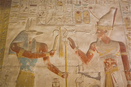 egyptian hieroglyphics - Bas-relief of the God Anubis on left and Ramses II on right, Temple of Seti I, Abydos, Egypt, North Africa, Africa Stock Photo - Rights-Managed, Code: 841-08220995