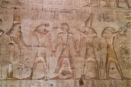 egyptian hieroglyphics - Bas-relief of Pharaoh Seti I in center with Egyptian Gods, Temple of Seti I, Abydos, Egypt, North Africa, Africa Stock Photo - Rights-Managed, Code: 841-08220992