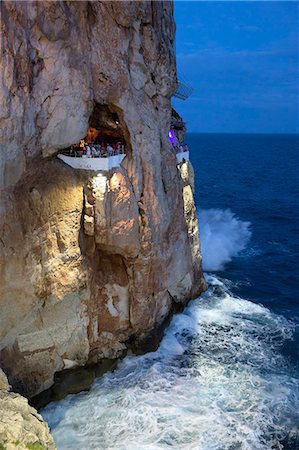 exterior bar - Bar built in cliff caves, Cova d'en Xoroi in evening, Cala en Porter, Menorca, Balearic Islands, Spain, Mediterranean, Europe Stock Photo - Rights-Managed, Code: 841-08221038
