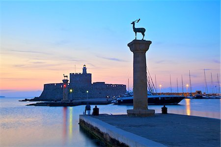 Bronze Doe and Stag statues at the entrance of Mandraki Harbour, Rhodes, Dodecanese, Greek Islands, Greece, Europe Stock Photo - Rights-Managed, Code: 841-08279013