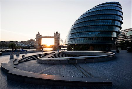 Sunrise behind Tower Bridge and The Mayor's Building (City Hall), London, England, United Kingdom, Europe Stock Photo - Rights-Managed, Code: 841-08357780