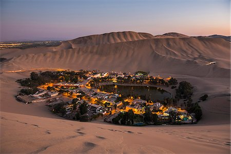 peru and culture - Huacachina, surrounded by sand dunes at night, Ica Region, Peru, South America Stock Photo - Rights-Managed, Code: 841-08421102