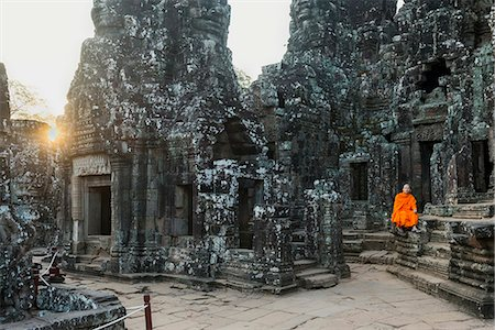 Monk sitting sitting in the Bayon temple, UNESCO World Heritage Site, Angkor, Siem Reap, Cambodia, Indochina, Southeast Asia, Asia Stock Photo - Rights-Managed, Code: 841-08421261