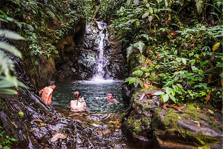 Tourists swimming under Cucharillos Waterfall, Choco Rainforest, Mashpi Cloud Forest, Pichincha Province, Ecuador, South America Stock Photo - Rights-Managed, Code: 841-08438524