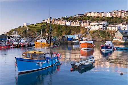 photography - Cornish fishing boats in Mevagissey harbour at sunrise, Cornwall, England, United Kingdom, Europe Stock Photo - Rights-Managed, Code: 841-08438771