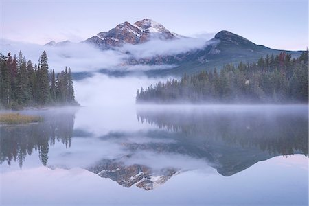 A misty Pyramid Mountain reflected in Pyramid Lake at dawn, Jasper National Park, Canadian Rockies, UNESCO World Heritage Site, Alberta, Canada, North America Stock Photo - Rights-Managed, Code: 841-08438784