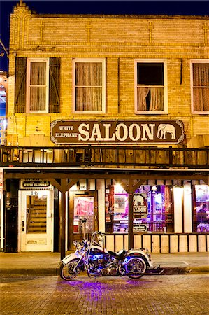 saloon - Bike outside a bar in Fort Worth Stockyards at night, Texas, United States of America, North America Stock Photo - Rights-Managed, Code: 841-08527756