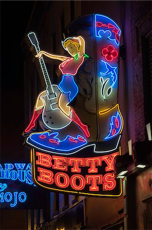 Neon signs and historic music clubs along Lower Broadway in Nashville, Tennessee, United States of America, North America Stock Photo - Rights-Managed, Code: 841-08569009