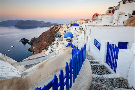 The last light of dusk over the Aegean Sea seen from the typical village of Oia, Santorini, Cyclades, Greek Islands, Greece, Europe Stock Photo - Rights-Managed, Code: 841-08645312