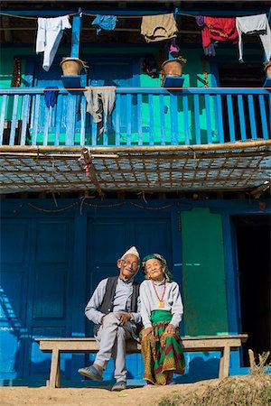 A old Nepali couple wearing traditional dress sit outside their house in Diktel, Khotang District, Nepal, Asia Stock Photo - Rights-Managed, Code: 841-08663621