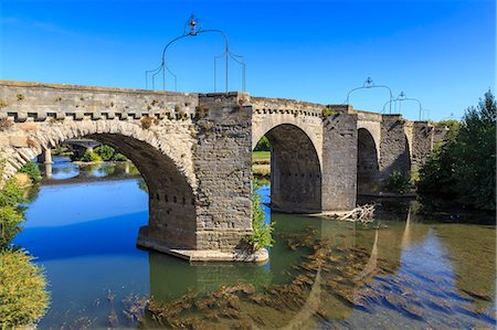 france - The 14th century medieval bridge Pont-Vieux, over River Aude, Ville Basse, Carcassonne, Languedoc-Roussillon, France, Europe Stock Photo - Rights-Managed, Code: 841-08797744