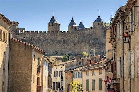 france - Ville Basse, with view to historic city ramparts, Carcassonne, UNESCO World Heritage Site, Languedoc-Roussillon, France, Europe Stock Photo - Rights-Managed, Code: 841-08797743