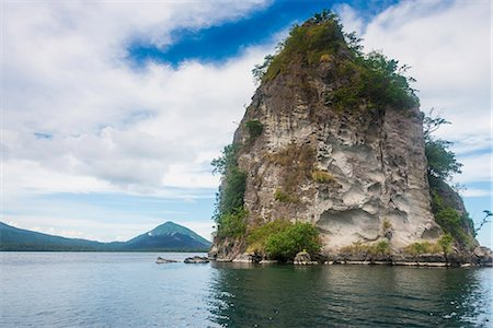 The Beehives (Dawapia Rocks) in Simpson Harbour, Rabaul, East New Britain, Papua New Guinea, Pacific Stock Photo - Rights-Managed, Code: 841-08821550