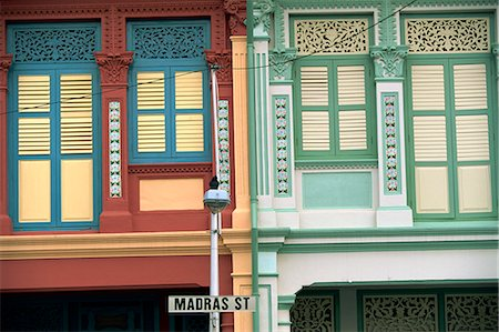 Close-up of old houses with shuttered windows and pilasters with decorative mouldings, and sign for Madras Street in Little India, Singapore, Southeast Asia, Asia Stock Photo - Rights-Managed, Code: 841-02704423