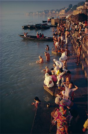 Pilgrims on the ghats by the River Ganges (Ganga), Varanasi (Benares), Uttar Pradesh State, India, Asia Stock Photo - Rights-Managed, Code: 841-02704506
