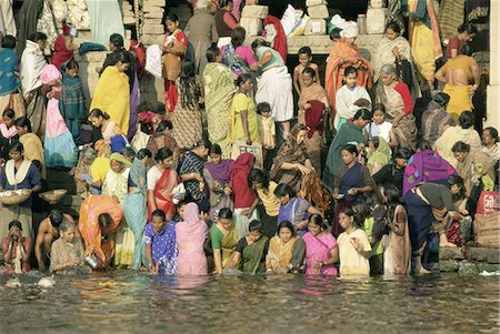 Hindus bathing in the early mornin in the holy river Ganges (Ganga) along Dasaswamedh Ghat, Varanasi (Benares), Uttar Pradesh state, India, Asia Stock Photo - Rights-Managed, Code: 841-02705785