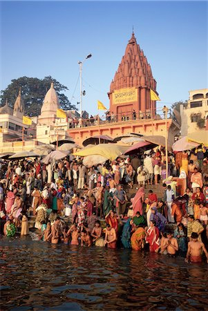 Hindus bathing in the early morning in the holy river Ganges (Ganga) along Dasaswamedh Ghat, Varanasi (Benares), Uttar Pradesh state, India, Asia Stock Photo - Rights-Managed, Code: 841-02705786